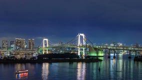 4K Timelapse of rainbow bridge at night, Tokyo, Japan stock footage