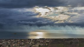 4K timelapse of rainy clouds over the sea. In Greece stock video footage