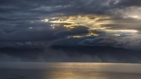 4K timelapse of rainy clouds over the sea. In Greece stock footage