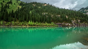 4K TimeLapse. A reflection on the water in the lake Kaindy in Tien Shan mountain. stock footage