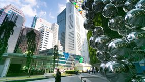 4k Timelapse of Shining atoms statue at Raffles Place. stock video