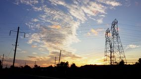 4K. Timelapse of Silhouette electricity pylons in sunset background - ULTRA HD,. 4k stock video footage