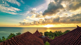 4K Timelapse. Sunrise overlooking the roofs of the bungalows and the Indian Ocean. 15 July 2015, Bali, Indonesia stock footage