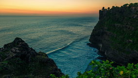 4K Timelapse. Sunset in the Indian Ocean on the background of the temple of Uluwatu. 15 July 2015, Bali, Indonesia stock video