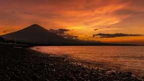 4K Timelapse. Sunset on the ocean and the volcano Gunung Agung. 15 July 2015, Bali, Indonesia stock footage