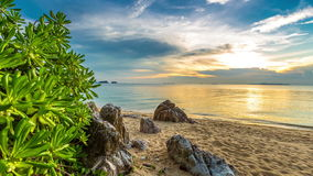 4K TimeLapse. Sunset on the rocky beach overgrown with plants, Koh Samui, Thailand stock video
