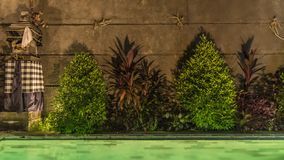 4K Timelapse of swimming pool in the night Balinese villa, swimming pool in the night hotel, The swimming pool at luxury stock video footage