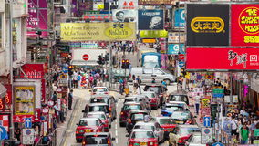 4k timelapse video of pedestrians and traffic in a busy street in Hong Kong stock video