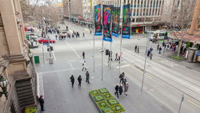 4k timelapse video of people and traffic in a busy intersection. Melbourne, Australia - Jul 26, 2015: 4k timelapse video of people and traffic in a busy stock footage