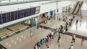 4k timelapse video of travellers in the arrival hall of Hong Kong International Airport stock video