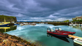 4K TimeLapse.  The water in the port reflects floating clouds. Stykkishólmur Harbour, Iceland. 15 June 2015 stock video