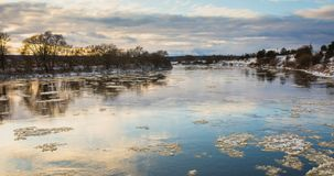 4k timelapse winter landscape with moving ice floes. Winter landscape with moving ice floes and clouds, 4k timelapse footage stock footage