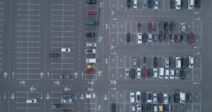 4k top aerial view of carpark with lots vacant space places traffic diagram. stock footage