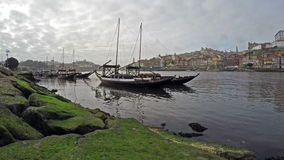 4K. Traditional Portuguese boats on Douro river, City of Porto, Portugal. Time Lapse in cloudy weather.  stock footage