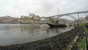 4K. Traditional Portuguese boats on Douro river, City of Porto, Portugal. Time Lapse in cloudy weather.  stock video