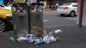 4K Trash spilling out of overfilled trash can on city street Taipei. Taiwan stock footage