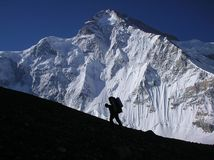 Mountain Climber Silhouette. Silhouette of climber ascending snow covered K2 mountain at 6000 meters. K2, also known as Chhogori Qogir, Ketu Kechu, and Mount Royalty Free Stock Photo
