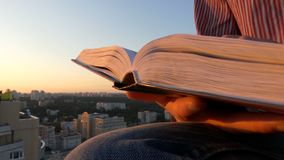 4k - turning pages of the book at sunset. The action in the real time stock video