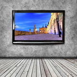 4K TV on the wall isolated. 4K TV isolated with picture on screen Royalty Free Stock Images
