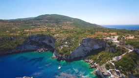 4K UHD Aerial view of  Agios Nikolaos blue caves  in Zakynthos Zante island, in Greece. 4K UHD Aerial view of Agios Nikolaos blue caves in Zakynthos Zante island stock footage