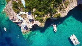 4K UHD Aerial view of  Agios Nikolaos blue caves  in Zakynthos Zante island, in Greece. 4K UHD Aerial view of Agios Nikolaos blue caves in Zakynthos Zante island stock video footage