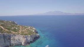 4K UHD Aerial view of  Agios Nikolaos blue caves  in Zakynthos Zante island, in Greece - Log. 4K UHD Aerial view of Agios Nikolaos blue caves in Zakynthos Zante stock video footage