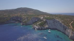 4K UHD Aerial view of  Agios Nikolaos blue caves  in Zakynthos Zante island, in Greece - Log. 4K UHD Aerial view of Agios Nikolaos blue caves in Zakynthos Zante stock footage