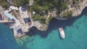 4K UHD Aerial view of Agios Nikolaos blue caves  in Zakynthos Zante island, in Greece - Log. 4K UHD Aerial view of Agios Nikolaos blue caves  in Zakynthos Zante stock video