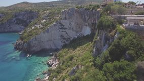 4K UHD Aerial view of  Agios Nikolaos blue caves  in Zakynthos Zante island, in Greece - Log stock video
