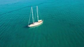 4K UHD Aerial view of a boat mooring in  Keri bay in Zakynthos Zante island, in Greece stock video