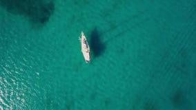 4K UHD Aerial view of a boat mooring in Keri bay in Zakynthos Zante island, in Greece. 4K UHD Aerial view of a boat mooring in Keri bay in Zakynthos Zante island stock video footage