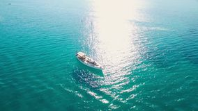 4K UHD Aerial view of a boat mooring in  Keri bay in Zakynthos Zante island, in Greece stock video footage