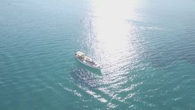 4K UHD Aerial view of a boat mooring in  Keri bay in Zakynthos Zante island, in Greece - Log. 4K UHD Aerial view of a boat mooring in Keri bay in Zakynthos Zante stock video footage