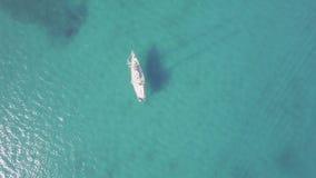 4K UHD Aerial view of a boat mooring in  Keri bay in Zakynthos Zante island, in Greece - Log stock video footage