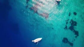 4K UHD Aerial view of boats mooring in  Agios Nikolaos blue caves  in Zakynthos Zante island, in Greece. 4K UHD Aerial view of boats mooring in  Agios Nikolaos stock footage