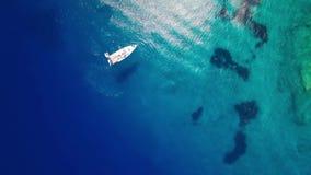 4K UHD Aerial view of boats mooring in  Agios Nikolaos blue caves  in Zakynthos Zante island, in Greece. 4K UHD Aerial view of boats mooring in  Agios Nikolaos stock video footage
