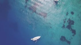 4K UHD Aerial view of boats mooring in  Agios Nikolaos blue caves  in Zakynthos Zante island, in Greece - Log. 4K UHD Aerial view of boats mooring in Agios stock video footage