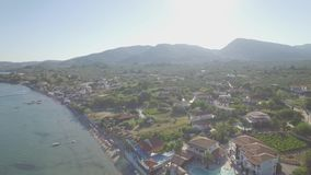 4K UHD  Aerial view of Laganas waterfront in Zakynthos Zante island, in Greece - Log. 4K UHD  Aerial view of Laganas waterfront in Zakynthos Zante island, in stock footage