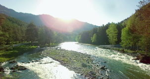 4k UHD aerial view. Low flight over fresh cold mountain river at sunny summer morning. stock footage