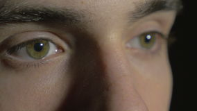 4k UHD - Close-up of a young man eyes opening and blinking stock video