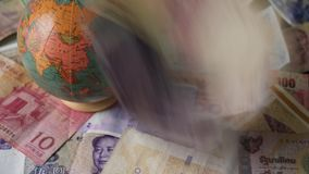 Foreign Currency International Finance Falling Banknotes Money Drop World Currency. 4K UHD footage of 4k 25FPS footage of Foreign Currency Falling Banknotes stock footage
