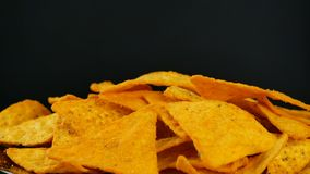 4K UHD footage of triangle nacho chips slowly rotating. Close up stock footage