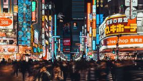 4K UHD time-lapse of crowded people crossing road and car traffic at Kabukicho, entertainment night life zone in Shinjuku, Tokyo stock video footage