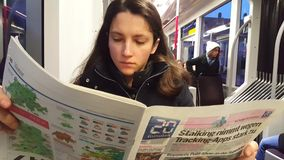 4K UHD video of morning reading newspaper in metropolitan tram. stock video