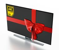 4K Ultra HD TV wrapped with red ribbon. 3D illustration Royalty Free Stock Image