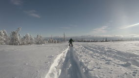 4K Ultra UHDTV 3840X2160 :  Little skier boy walks on the deep snow track stock video