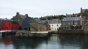 4K UltraHD Buildings by the Stromness harbor in Orkney, Scotland stock video footage