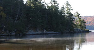 4K UltraHD Mist rises from Algonquin lake in fall. 4K UltraHD A Mist rises from Algonquin lake in fall stock video