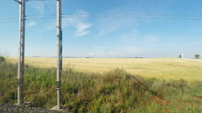 4K UltraHd Point of view of quiet countryside from a moving train stock footage