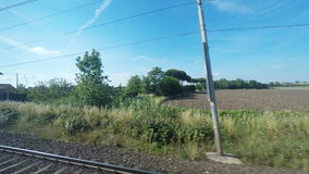 4K UltraHd Point of view of tranquil countryside from a train stock footage